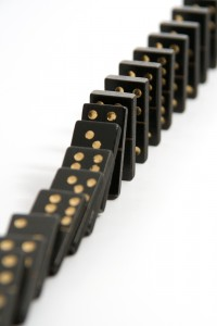 bigstock-Black-Dominoes-Falling-Down-In-1081634